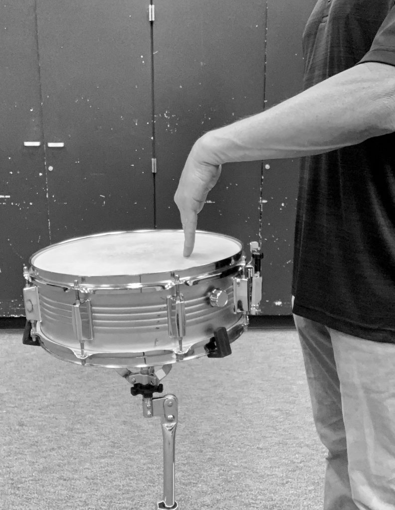Finger on snare head